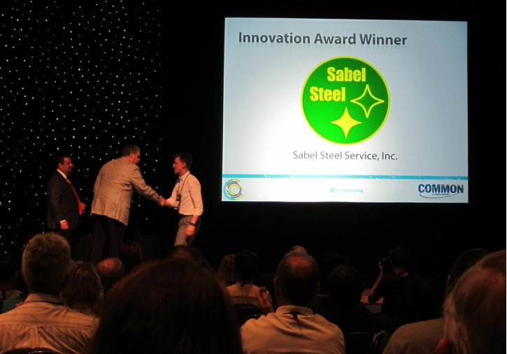 Chuk Shirley accepting COMMON innovation award on behalf of Sabel Steel, April 26, 2015